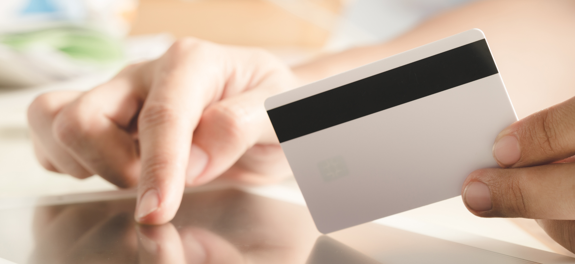 Online Shopping Concept with Hand Holding Credit Card